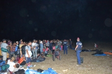 Gathering refugees at the collection point before taking them to the temporary camp.