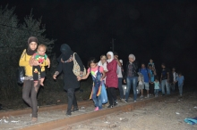 Refugees cross into Hungary from Serbia at midnight.