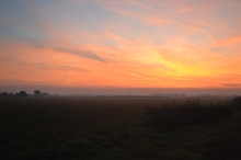 The eastern sky aflame: dawn at the Hungarian-Serbian border.