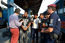 Migration Aid volunteer talking to migrants at the Western Railway Station.
