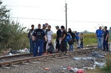 Hungarian police prevent refugees from crossing the border.