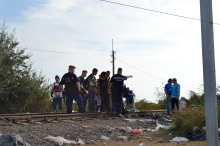 Directing refugees to the regular border crossing.