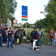 Hungarian police and refugees at the regular border crossing.