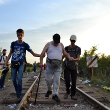 Refugees pass through the final gap in the Hungarian-Serbian border.