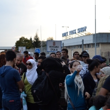 Refugees waiting to board buses at the regular border crossing.