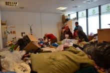 Pile of donations at the Migration Aid station.