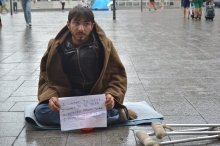 Refugee with sign.
