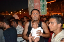 Father and baby at refugee demonstration.