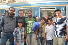 Refugees prepare to board train they think will take them to Germany.