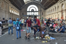Refugees waiting for a train they think will take them to Germany.