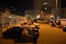 Refugees sleeping outside the Eastern Railway Station.