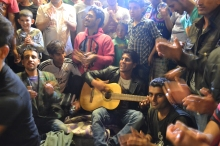 Playing Pashto music in the transit zone.