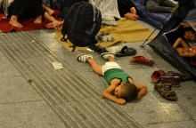 Young refugee sleeping rough.