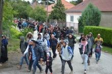 Migrants walk through village of Hegyeshalom.