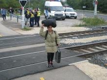 Rare solitary migrant woman.