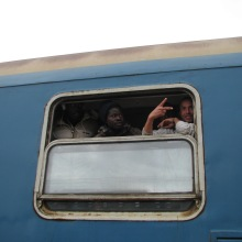Migrants arrive to Hegyeshalom railway station.