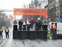 Protesters play Stalinist-era communist anthems from loudspeakers on stage along the Peace March route.