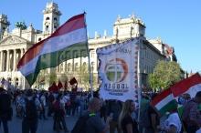 Demonstrator holding flag of nationalist opposition party Jobbik.