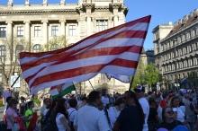 Demonstrators with nationalist Árpád-striped flag.
