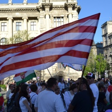 Demonstrators with nationalist Árpád-striped flag.