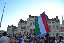 Demonstrator with Hungarian national flag and European Union flag together.